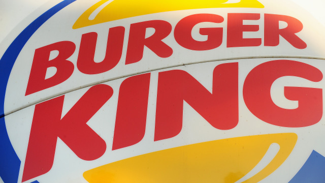 A Burger King sign outside a restaurant in Glendale, California, on September 2, 2010. Burger King, the second-largest US hamburger chain, will be sold to 3G Capital investment house for four billion dollars, the fast food chain announced Thursday. 3G Capital agreed to acquire all Burger King stock for 24 dollars per share in cash, representing a 46 percent premium, and will also assume the company's outstanding debt, Burger King said in a statement. AFP PHOTO / Robyn Beck (Photo credit should read ROBYN BECK/AFP/Getty Images)
